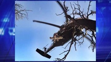 An injured man is hoisted into a helicopter after falling from a mountaintop near Nogales. By Jennifer Thomas