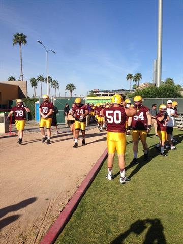 The ASU offense arrives to practice. By Brad Denny