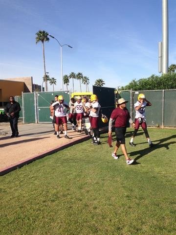 The ASU defense arrives to practice. By Brad Denny