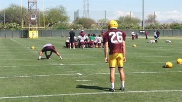 Haack (26) participates in spring drills on March 25, 2014 By Brad Denny