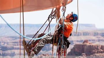 Workers from a Phoenix-based company had an awe-inspiring view as they dangled from ropes to clean the glass at the Grand Canyon Skywalk. By Mike Gertzman