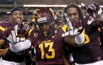 Wadood (13) celebrates the win over Oregon State last November. By Ralph Freso