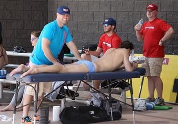 MESA, AZ - APRIL 23:  Michael Phelps gets a massage druing a break from practice for the Arena Grand Prix at the Skyline Aquatic Center on April 23, 2014 in Mesa, Arizona.  (Photo by Christian Petersen/Getty Images) By Christian Petersen