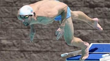 MESA, AZ - APRIL 23:  Michael Phelps dives into the pool as he practices for the Arena Grand Prix at the Skyline Aquatic Center on April 23, 2014 in Mesa, Arizona.  (Photo by Christian Petersen/Getty Images) By Christian Petersen