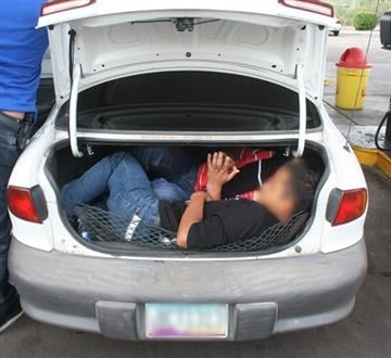 Undocumented aliens found inside trunk of Chevrolet Cavalier By Christina O'Haver