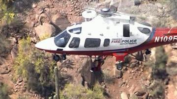 A man and his 5-year-old son were rescued by helicopter after getting stranded on Camelback Mountain on Thursday afternoon. By Mike Gertzman