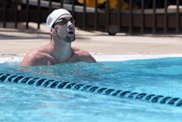 MESA, AZ - APRIL 24:  Michael Phelps warms up in the practice pool during day one of the Arena Grand Prix at the Skyline Aquatic Center on April 24, 2014 in Mesa, Arizona.  (Photo by Christian Petersen/Getty Images) By Christian Petersen
