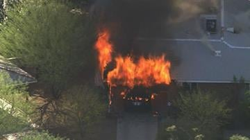 A home was severely damaged Wednesday afternoon when a car fire spread to the attic, according to Capt. Jonathan Jacobs with the Phoenix Fire Dept. The home is near 32nd Street and Thomas Road. By Mike Gertzman