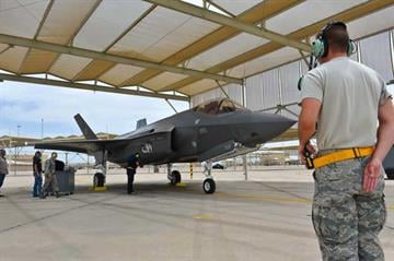 Senior Airman Paul Swanson, 61st Aircraft Maintenance Unit crew chief, marshals in an F-35 Lightning II at Luke Air Force Base, Ariz., May 6, 2014. The jet flew the first local F-35 training sortie at Luke on May 5, 2014. By Mike Gertzman