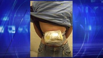 CPB officials said a search of a 22-year-old man led to the discovery of three packages of heroin strapped to his stomach and groin. By Jennifer Thomas
