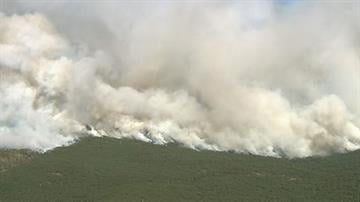 A wind-whipped wildfire in a canyon near Sedona now is estimated at 7 square miles and windy conditions have grounded air tankers that were fighting the blaze in northern Arizona. By Mike Gertzman