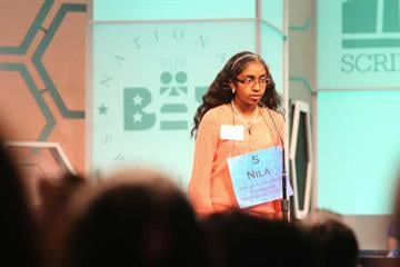 "Gilbert student Nila Dhinaker, 12, prepares to spell ""apothecary"" to survive the third round of the National Spelling Bee. By Jennifer Thomas"