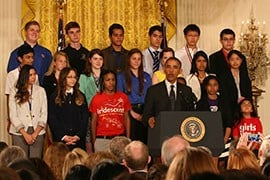 Phoenix teens Diserae Sanders - front row, left - and Martin Carranz and Quenan Ruiz - back row, center - listen as President Barack Obama announces new science education initiatives during the White House Science Fair. By Aubree Abril