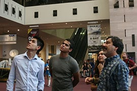 Carl Hayden Community High School students and their instructor on a visit to the Smithsonian Air and Space Museum Tuesday. From left, Quenan Ruiz, 17, Martin Carranza, 18, Diserae Sanders, 17, and Faridoden Lajvardi. By Aubree Abril