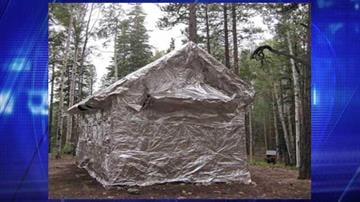 Firefighters wrapped the historic Kanabownits Cabin with a fire-resistant aluminum material that reflects heat to help protect the structure in the event fire burns around it. By Jennifer Thomas