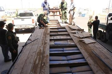 Flatbed trailer with hidden compartment filled with marijuana (photo courtesy of Customs and Border Protection) By Jayson Chesler