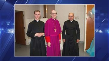 Father Kenneth Walker, 29, and Father Joseph Terra, 56, with Bishop Thomas Olmstead (right) in May. By Catherine Holland