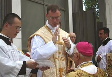 Father Walker gives his first blessing to his ordaining bishop, Bishop Bruskewitz By Catherine Holland