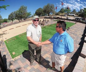 Ted Ihrman, superintendent of the Arizona Pioneers Home and Cemetery, and JP Vicente, the Granite Mountain 19 family services coordinator, shake hands Wednesday on an agreement over the layout and design of the memorial site. By Jayson Chesler
