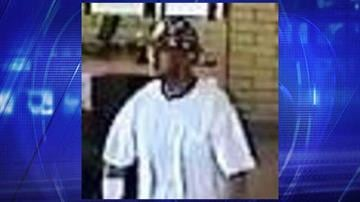 Surveillance photo of robbery suspect at BBVA Compass Bank By Jennifer Thomas