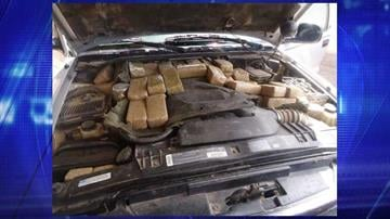 CBP officers assigned to the Port of Douglas intercepted a smuggling vehicle with marijuana packages hidden under the front hood. By Jennifer Thomas