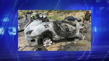 This photo provided by the Utah Department of Public Safety shows a damaged vehicle from a head-on collision Sunday, July 6, 2014, in southern Utah. By Jennifer Thomas