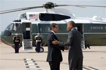President Barack Obama is greeted by Texas Gov. Rick Perry as he arrives at Dallas/Fort Worth International Airport, Wednesday, July 9, 2014. The president is expected to attend a meeting on immigration, (AP Photo/Jacquelyn Martin) By Jacquelyn Martin