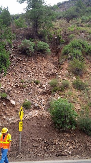 A thunderstorm in Oak Creek Canyon temporarily forced the closure of State Route 89A due to flash foods and debris. This mountain slope eroded, causing debris and rocks to fall onto the roadway. By Christina O'Haver
