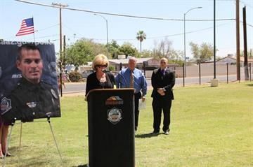 Mary Ann Mendoza, the mother of Sgt, Brandon Mendoza, spoke at a May 22 ceremony during which the baseball field at Guerrero Rotary Park was renamed in her son's honor. By Catherine Holland