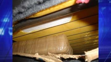 Officers searching a smuggling vehicle discover packages of marijuana hidden within the seats. By Jayson Chesler