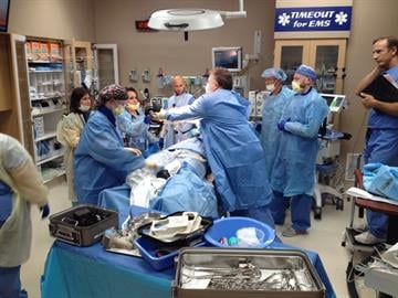 Dr. Christopher Salvino, West Valley Hospital's trauma medical director (far right), watches during one of the mock drills leading up to the opening of West Valley Hospital's Level 1 Trauma Center opening on July 21. By Jennifer Thomas