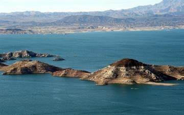 LAKE MEAD, NRA, NV - JULY 14:  Boaters pass near the Boulder Islands on July 14, 2014 in the Lake Mead National Recreation Area, Nevada. (Photo by Ethan Miller/Getty Images) By Ethan Miller