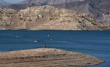 LAKE MEAD, NRA, NV - JULY 17:  Visitors ride personal watercraft in front of mineral-stained rocks at Hemenway Harbor on July 17, 2014 in the Lake Mead National Recreation Area, Nevada. (Photo by Ethan Miller/Getty Images) By Ethan Miller