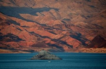 LAKE MEAD, NRA, NV - JULY 17:  A boat sails on Lake Mead on July 17, 2014 in the Lake Mead National Recreation Area, Nevada. (Photo by Ethan Miller/Getty Images) By Ethan Miller