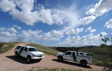 U.S. Border Patrol agents patrol along the border fence between Arizona and Mexico at the town of Nogales on July 28, 2010. (Photo credit: MARK RALSTON/AFP/Getty Images) By MARK RALSTON