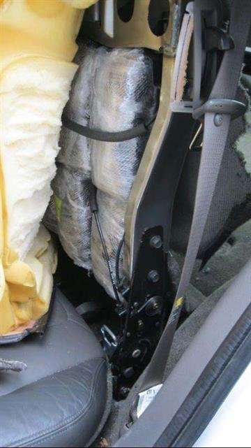 Packages of methamphetamine were removed from the seats of a smuggling vehicle by CBP officers at the Mariposa crossing. By Jennifer Thomas