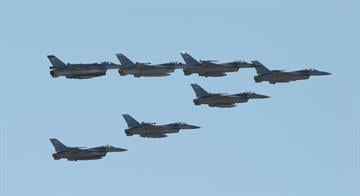 A formation of seven F-16 Fighting Falcons performs a flyover April 30, 2012, at Luke Air Force Base. By Jennifer Thomas
