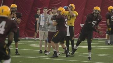 Gerhart (3) and Manny Wilkins (5) throw during practice By Brad Denny