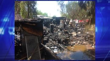Phoenix firefighters responded to a trailer fire near Central Avenue and Broadway Road. By Jennifer Thomas
