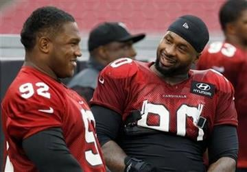 Arizona Cardinals' Darnell Dockett (90) talks with Dan Williams (92) during NFL football training camp practice Wednesday, Aug. 13, 2014, in Glendale, Ariz. (AP Photo/Ross D. Franklin) By Ross D. Franklin