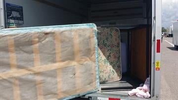 The individuals were hidden behind mattresses. By Jennifer Thomas