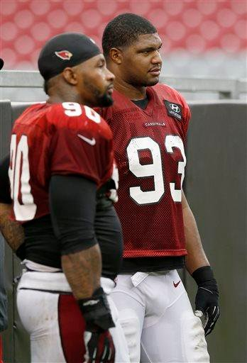 Arizona Cardinals' Calais Campbell (93) stands next to teammate Darnell Dockett, left, as they watch the second team defense during NFL training camp practice Wednesday, Aug. 13, 2014, in Glendale, Ariz. (AP Photo/Ross D. Franklin) By Ross D. Franklin