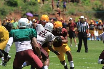 Calhoun (4) aims to make a tackle during the scrimmage at Camp Tontozona By Brad Denny