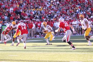D.J. Foster runs through the Lobo defense. By Brad Denny