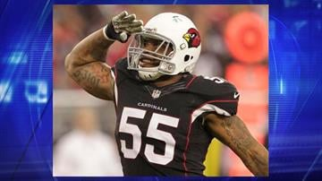 In this Nov. 10, 2013, file photo, Arizona Cardinals outside linebacker John Abraham salutes the crowd after sacking Houston Texans quarterback Case Keenum during the second half of an NFL football game in Glendale, Arizona. By Jennifer Thomas