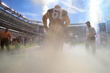 EAST RUTHERFORD, NJ - SEPTEMBER 14:  The New York Giants take the field against the Arizona Cardinals during a game at MetLife Stadium on September 14, 2014 in East Rutherford, New Jersey.  (Photo by Ron Antonelli/Getty Images) By Ron Antonelli