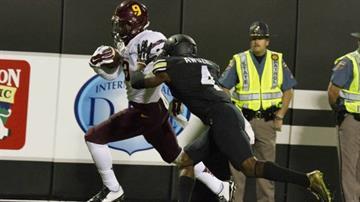 Ballage scores a touchdown against Colorado By Brad Denny