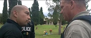 Cecilio Cruz and Detective Sgt. Tod Moore By Jennifer Thomas