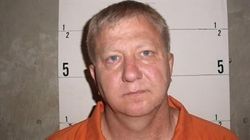 A 2005 mug shot when Gregory Lynn Shrader was arrested on unrelated matters by the Delaware County Sheriff's Department By Catherine Holland