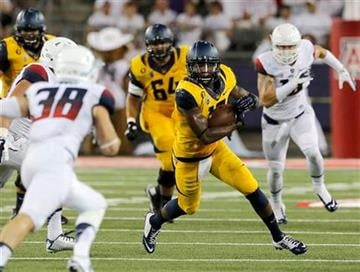 California wide receiver Darius Powe (10) runs with the ball after a reception against Arizona during the first half of an NCAA college football game, Saturday, Sept. 20, 2014, in Tucson, Ariz. (AP Photo/Rick Scuteri) By Rick Scuteri